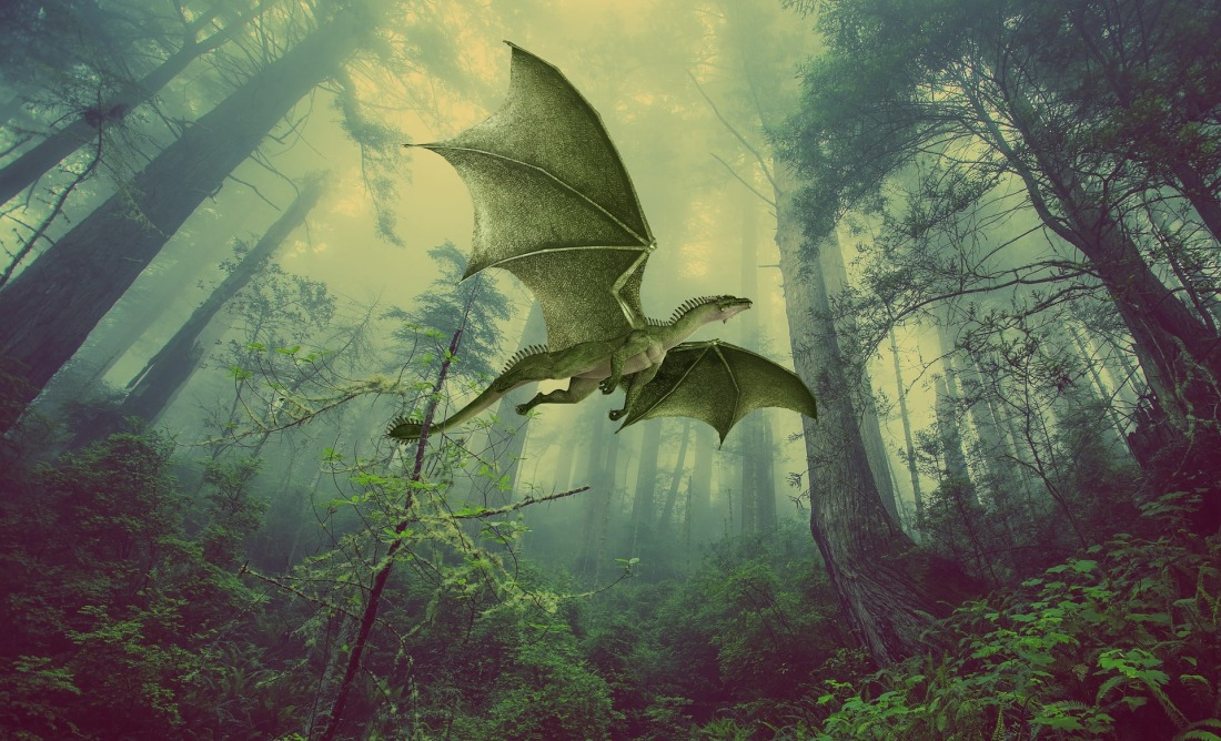Green dragon flying over forest