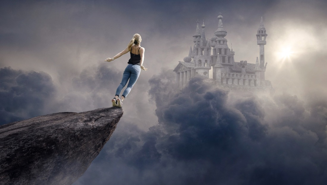 Fantasy of young girl falling over edge of cliff towards floating castle in the sky
