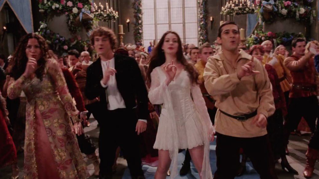 A still from the movie Ella Enchanted, showing Minnie Driver, Anne Hathaway and Hugh Dancy as they dance.