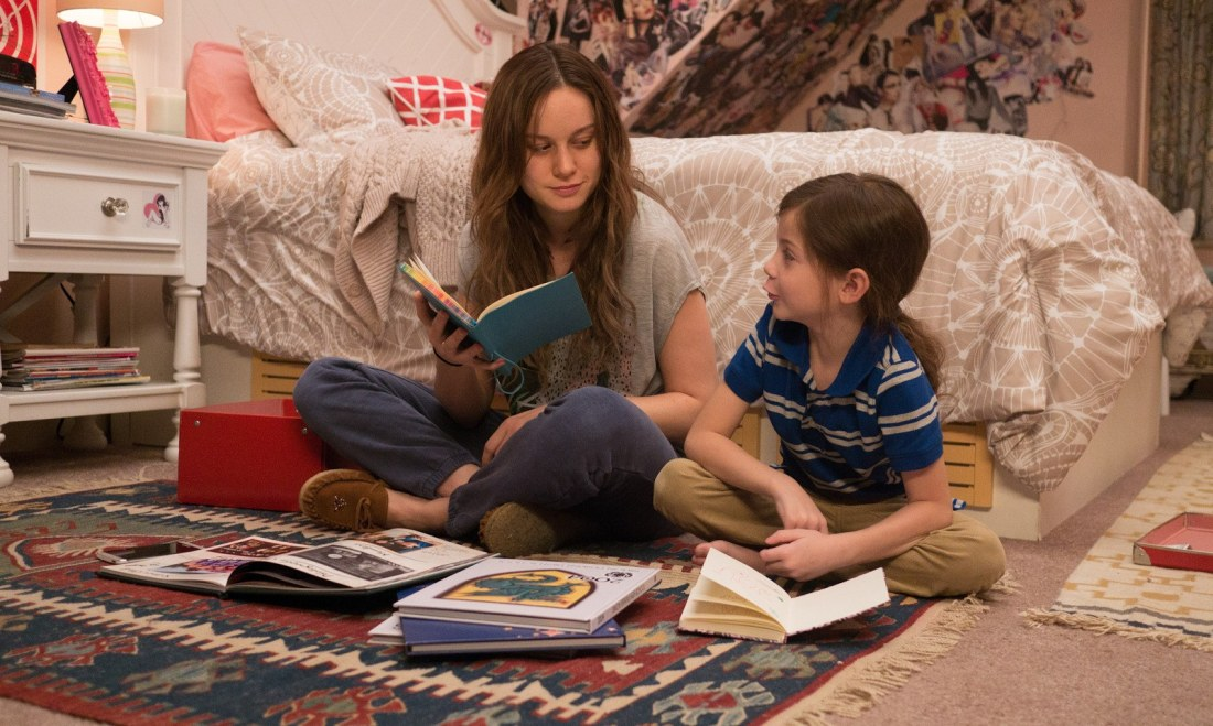 A still from the movie Room, showing Ma and Jack reading on the floor of Ma's old room.