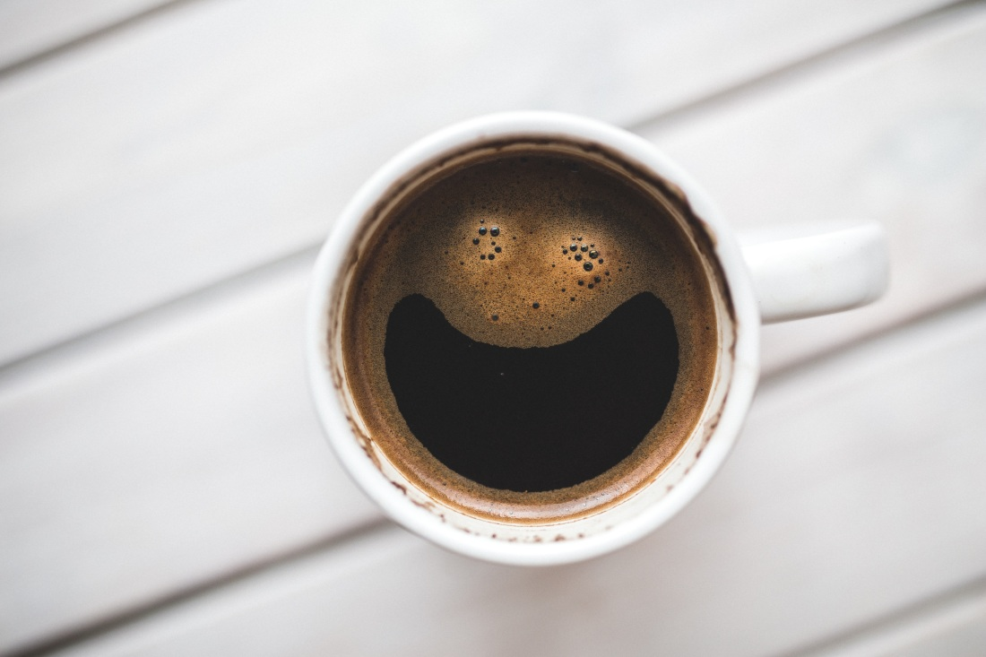 cup of coffee with smiley face