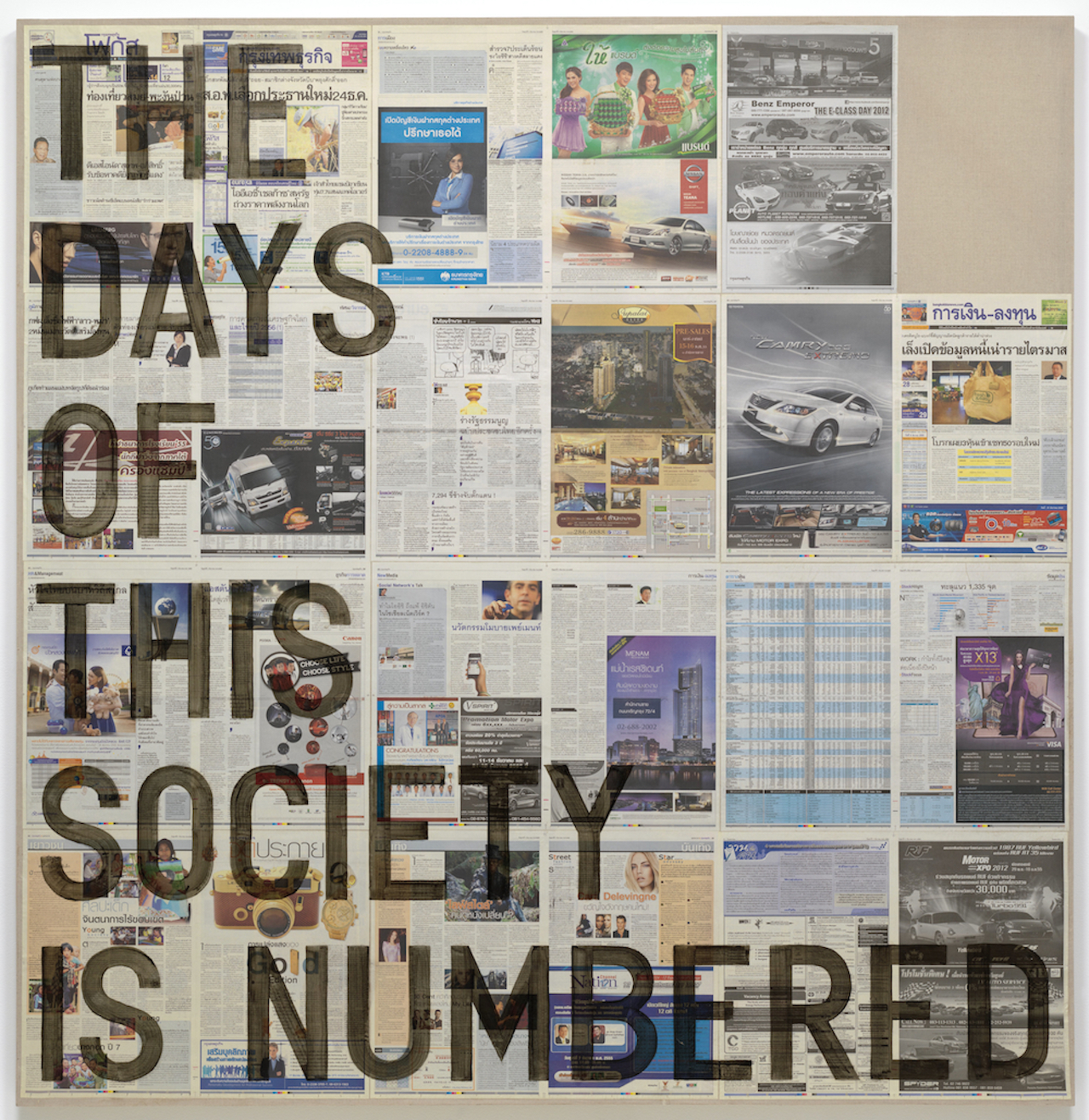 "artwork by Rirkit Tiravanija on which the words ""THE DAYS OF THIS SOCIETY IS NUMBERED"" are stencilled across newspaper pages"